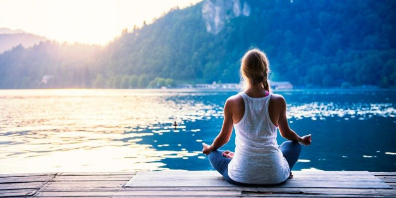 Woman Meditating by Lake-Mental Health